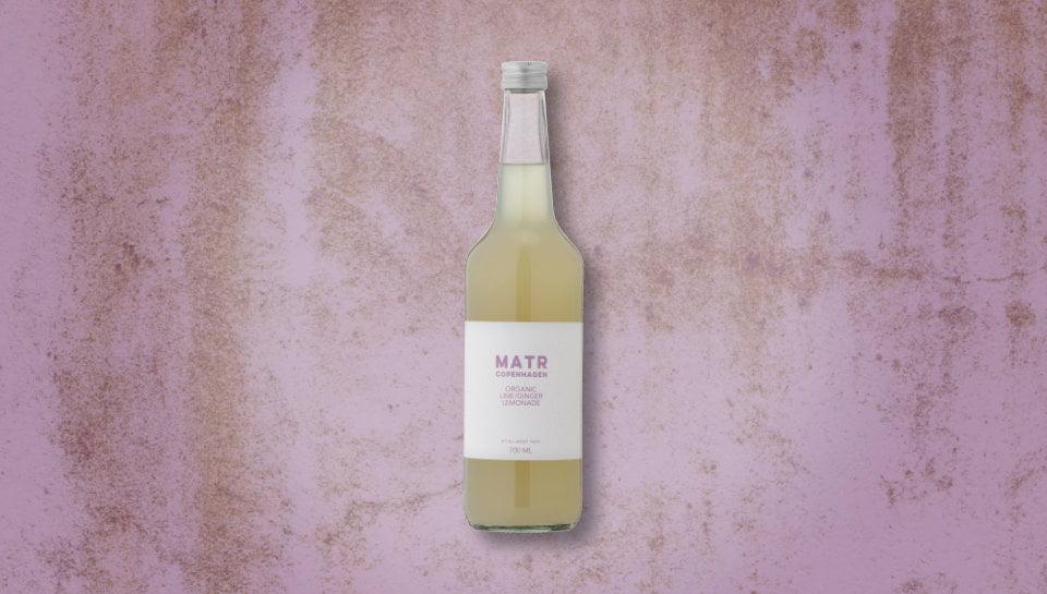 Organic Lime Ginger Lemonade in glass bottle