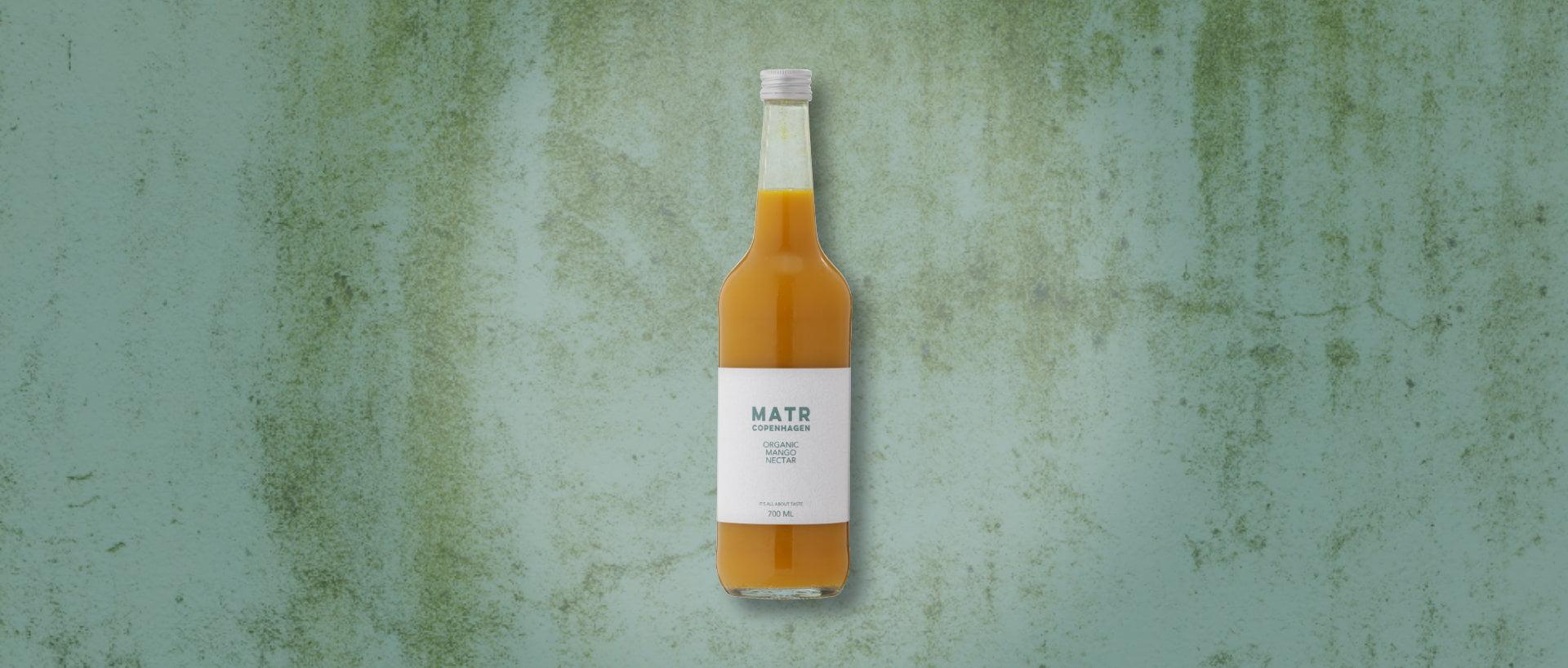 Organic Mango Nectar in glass bottle